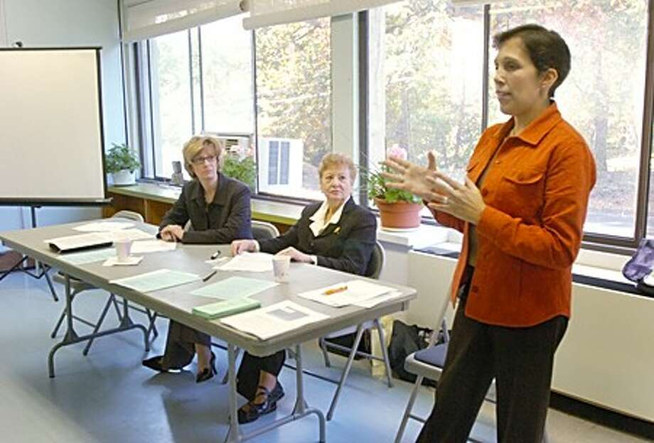 The Senior Umbrella Executive Committe member Chris Cain talks about Medicare savings while members and presenters Denise Cesareo and Laura Eepstein look on during the organization''s 35th Annual Meeting Tuesday at the Norwalk Senior Center on Allen Rd. Hour photo / Erik Trautmann