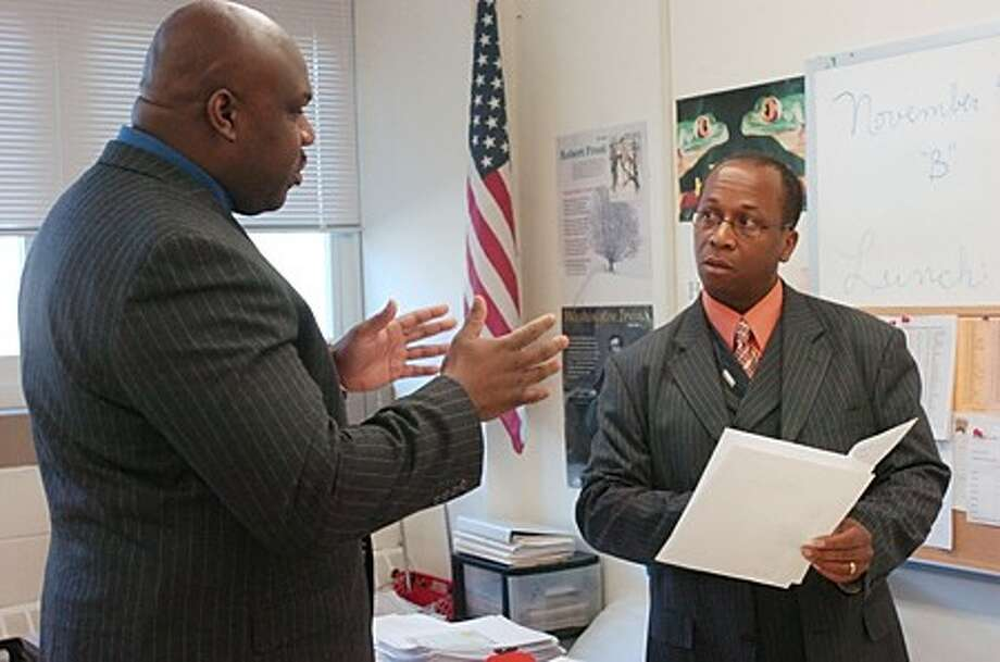 Fred Gill of the Metropolitan Transportation Authority Recruitment and Sourcing Roundtable Team, right, helps Kevin Taylor with his resume and interviewing skills during the MTA career fair Saturday at Ponus Ridge Middle School. Hour photo / Erik Trautmann