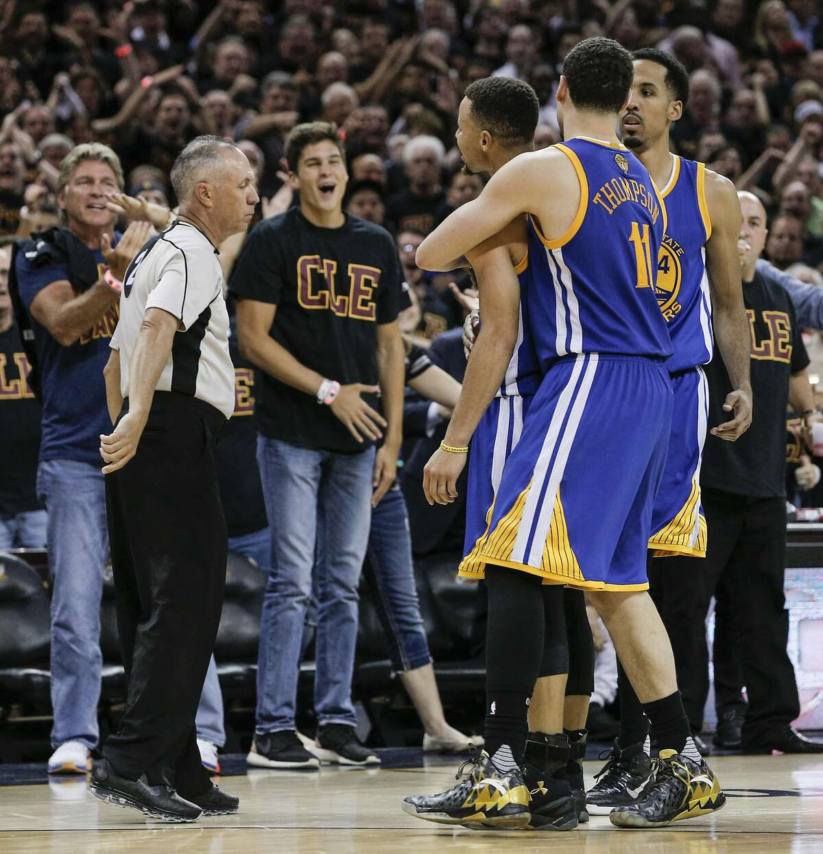 Golden State Warriors' Stephen Curry is held back by teammates Shaun Livingston and Klay Thompson as curry argued a call with referee Jason Phillips after being ejected from the game in the fourth quarter during Game 6 of the NBA Finals at The Quicken Loans Arena on Thursday, June 16, 2016 in Cleveland, Ohio.
