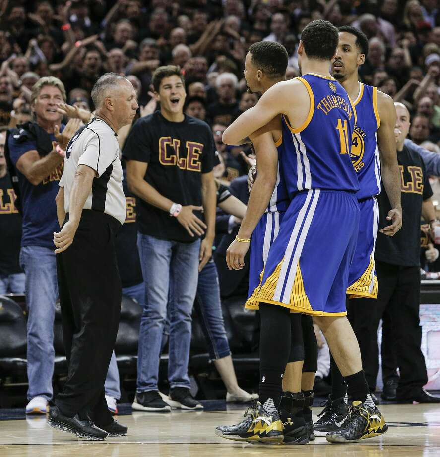 Golden State Warriors' Stephen Curry is held back by teammates Shaun Livingston and Klay Thompson as curry argued a call with referee Jason Phillips after being ejected from the game in the fourth quarter during Game 6 of the NBA Finals at The Quicken Loans Arena on Thursday, June 16, 2016 in Cleveland, Ohio. Photo: Carlos Avila Gonzalez, The Chronicle