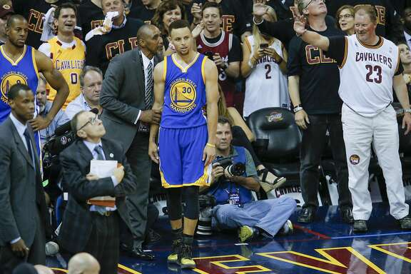 Golden State Warriors' manager of security Ralph Walker talks to Stephen Curry after Curry fouled out of the game in the fourth quarter during Game 6 of the NBA Finals at The Quicken Loans Arena on Thursday, June 16, 2016 in Cleveland, Ohio.