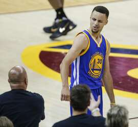 Golden State Warriors' Stephen Curry reacts towards Cleveland Cavaliers' fans after fouling out of the game in the fourth quarter during Game 6 of the NBA Finals at The Quicken Loans Arena on Thursday, June 16, 2016 in Cleveland, Ohio.
