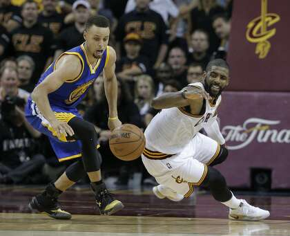 1fa08003891 Golden State Warriors  Stephen Curry and Cleveland Cavaliers  Kyrie Irving  chase a loose ball in the fourth quarter during Game 6 of the NBA Finals at  The ...