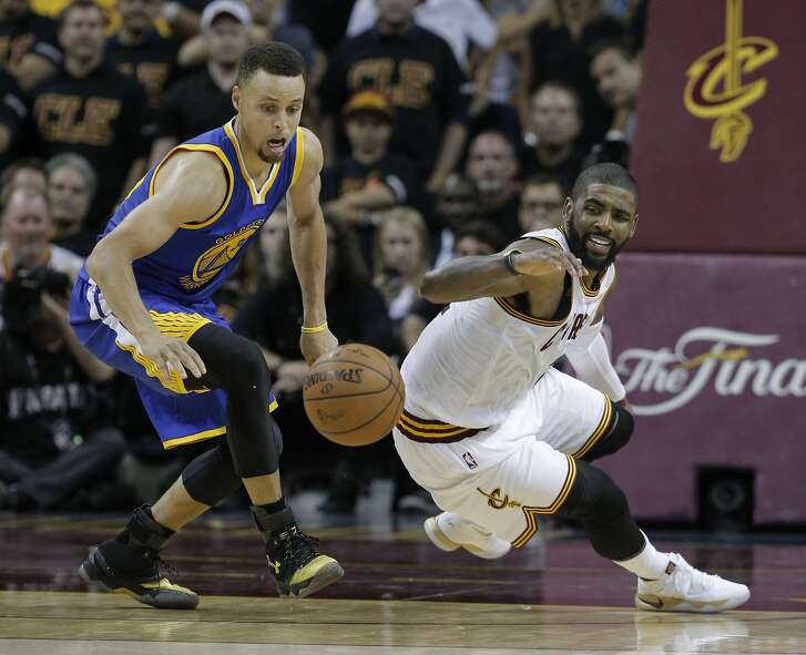 Golden State Warriors' Stephen Curry and Cleveland Cavaliers' Kyrie Irving chase a loose ball in the fourth quarter during Game 6 of the NBA Finals at The Quicken Loans Arena on Thursday, June 16, 2016 in Cleveland, Ohio. Curry was called for his fifth foul of the game on the play.
