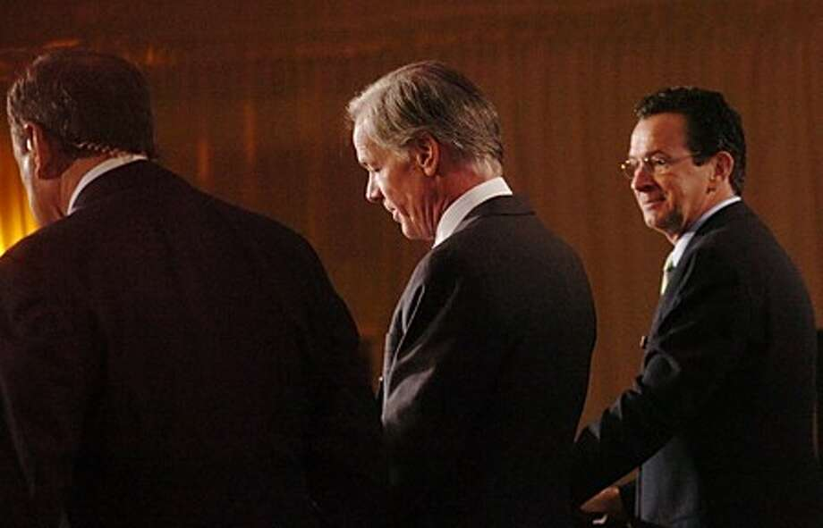Former Stamford mayor Dan Malloy, right, and Republican Tom Foley, center, participate in a gubernatorial debate at the Hyatt Regency in Greenwich on Friday, Oct. 1. Hour photo / Erik Trautmann