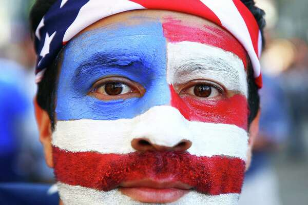 Sergio Garcia, of Miami, wears American flag face paint before the Copa America quarterfinals game between the United States and Ecuador at CenturyLink Field in Seattle on June 16, 2016.