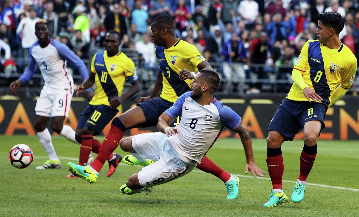 United States' Clint Dempsey (8) crosses the ball to Gyasi Zardes (9) to set up Zardes to score during the second half of the Copa America quarterfinals game between the United States and Ecuador at CenturyLink Field in Seattle on June 16, 2016.
