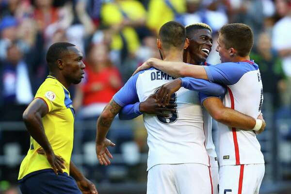 U.S. men's national team members (l to r) Clint Dempsey, Gyasi Zardes and Matt Besler celebrate after Zardes' goal in the team's 2-1 win over Ecuador in the Copa America quarterfinals on June 16, 2016, at CenturyLink Field in Seattle.
