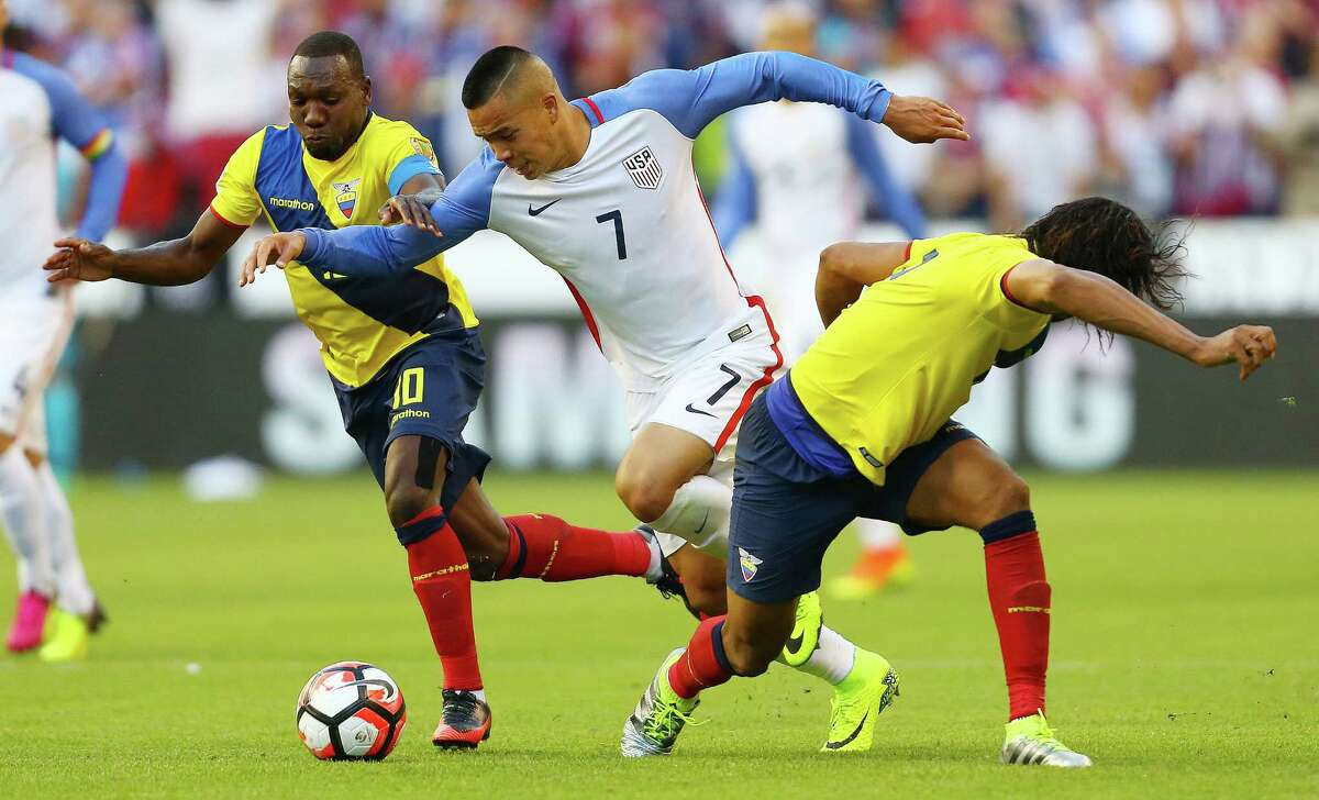 United States' Bobby Wood (7) is sandwiched between Ecuador players Walter Ayovi (10) and Arturo Mina during the second half of the Copa America quarterfinals game between the United States and Ecuador at CenturyLink Field in Seattle on June 16, 2016.