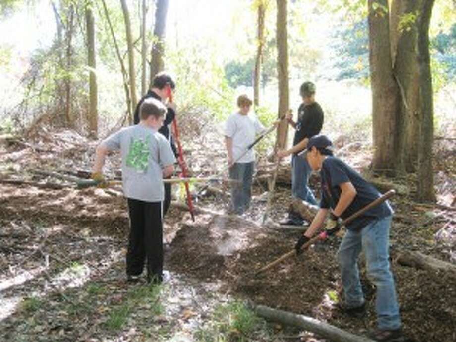 Norwalk Boy Scout cleans up Land Trust property