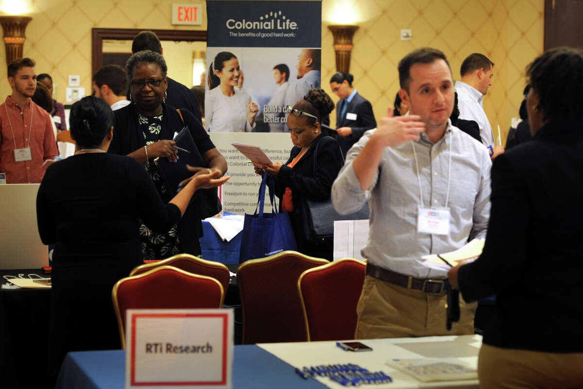 Job candidates make the rounds on June 10, 2016 at the RecruitCT Job Fair in Trumbull, Conn. Average weekly earnings in Connecticut spiked to their highest level in 10 years, with the state Department of Labor cautioning the gain was likely a statistical anomaly introduced during random survey samples.