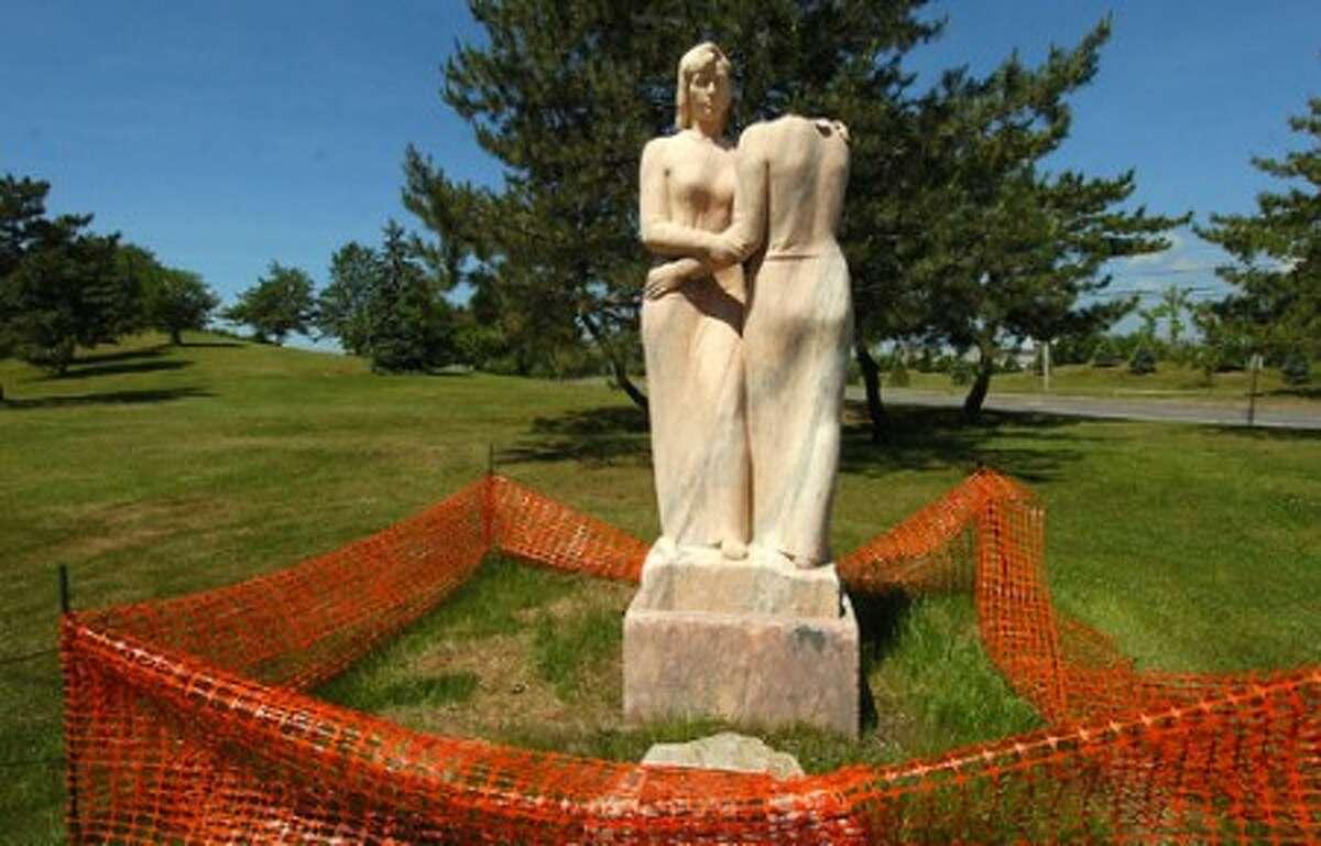 Photo/Alex von Kleydorff. Vandalized ''Neighbors'' statue in Stamford.