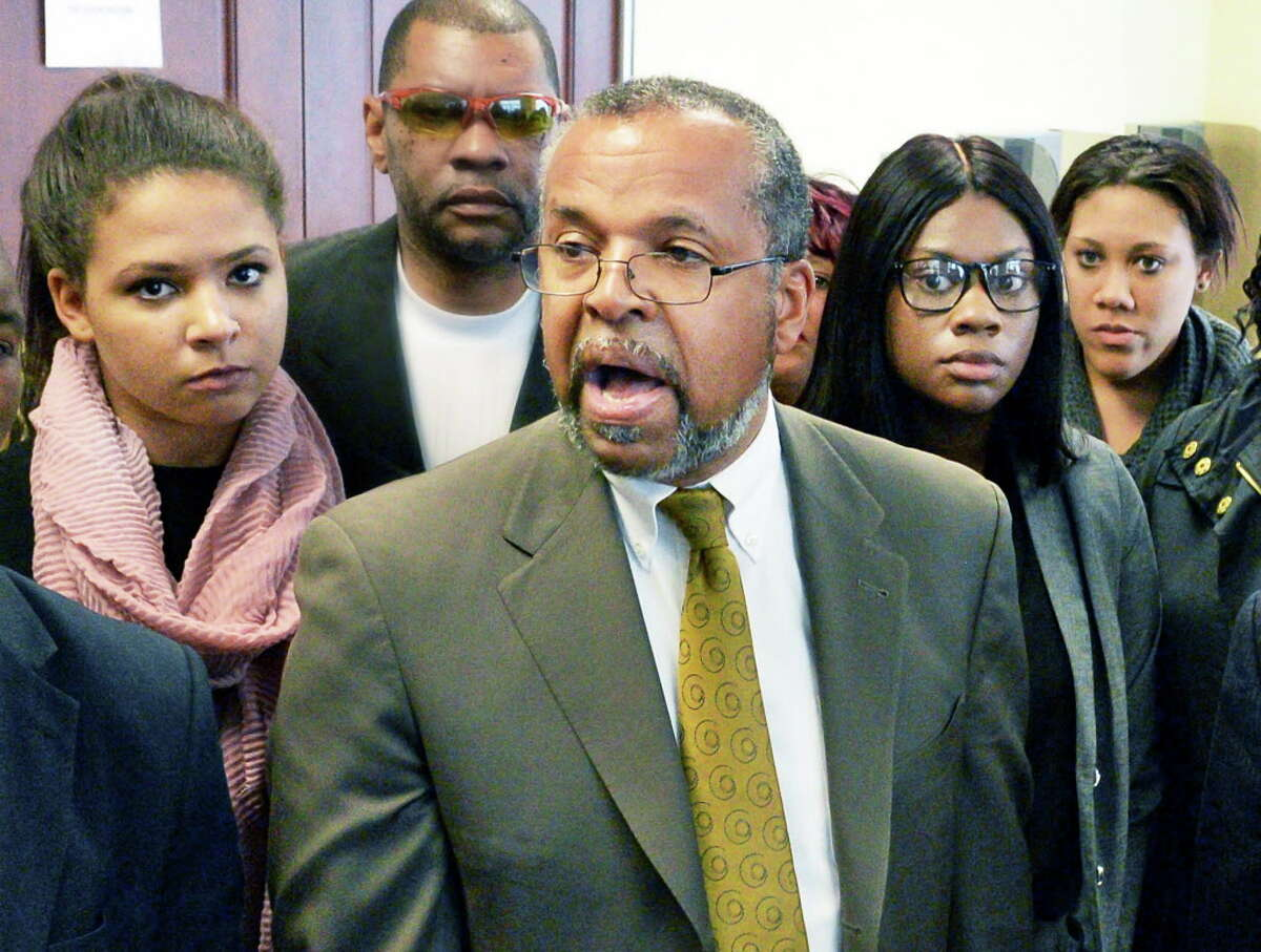 Attorney Frederick Brewington, center, speaks to reporters as the UAlbany students accused of a CTDA bus attack, Alexis Briggs, left, Asha Burwell and Ariel Agudio, right, leave Albany County Court following their arraignment Wednesday May 4, 2016 in Albany, NY. (John Carl D'Annibale / Times Union)