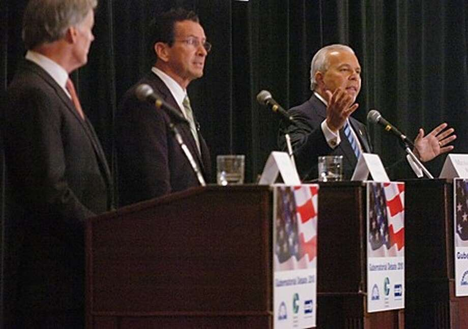 Lt Governor Michael Fedele, right, speaks during the gubernatorial debate at the Stamford Plaza Tuesday. Hour photo / Erik Trautmann