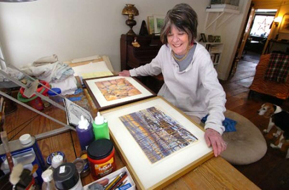 Photo/Alex von Kleydorff. Wilton artist Jen Shelley organizes some of her paintings for her part in the Wilton Library Mixed Talent show.