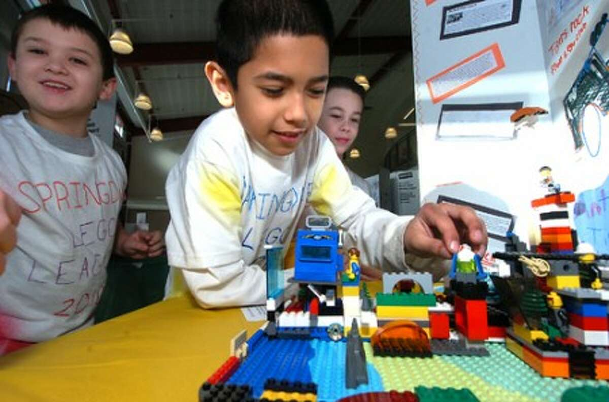 Photo/Alex von Kleydorff. 3rd grader jason Romero adjust a part on his Springdale Elementary Schools team ''Tigers on the Move'' Lego animal rescue model during the 2010 Junior Lego league Expo at AITE in Stamford.