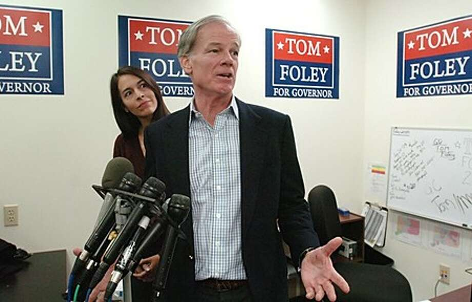 GOP gubernatorial candidate Tom Foley appears at a press conference at his campiagn office in Stamford with his wife, Leslie, to address questions abou the unresolved election. Hour photo / Erik Trautmann