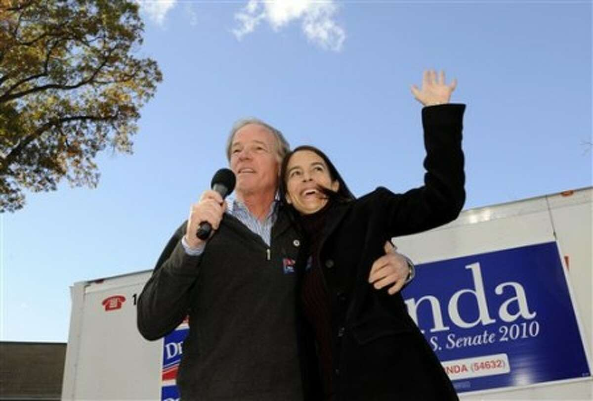 Connecticut Republican gubernatorial candidate Tom Foley, left, with his wife Leslie Fahrenkopf Foley during a rally, Sunday, Oct. 31, 2010, in Darien Conn. (AP Photo/Fred Beckham)