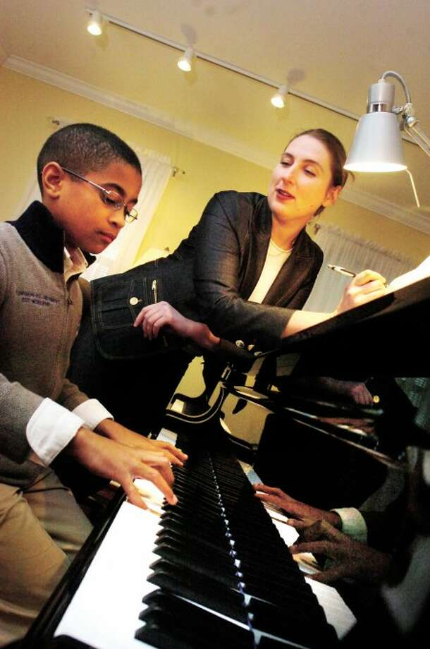 Piano teacher Svitlana Fiorito with 10 year old prodigy Seth Blumer at her studio in Stamford on Tuesday. hour photo/matthew vinci