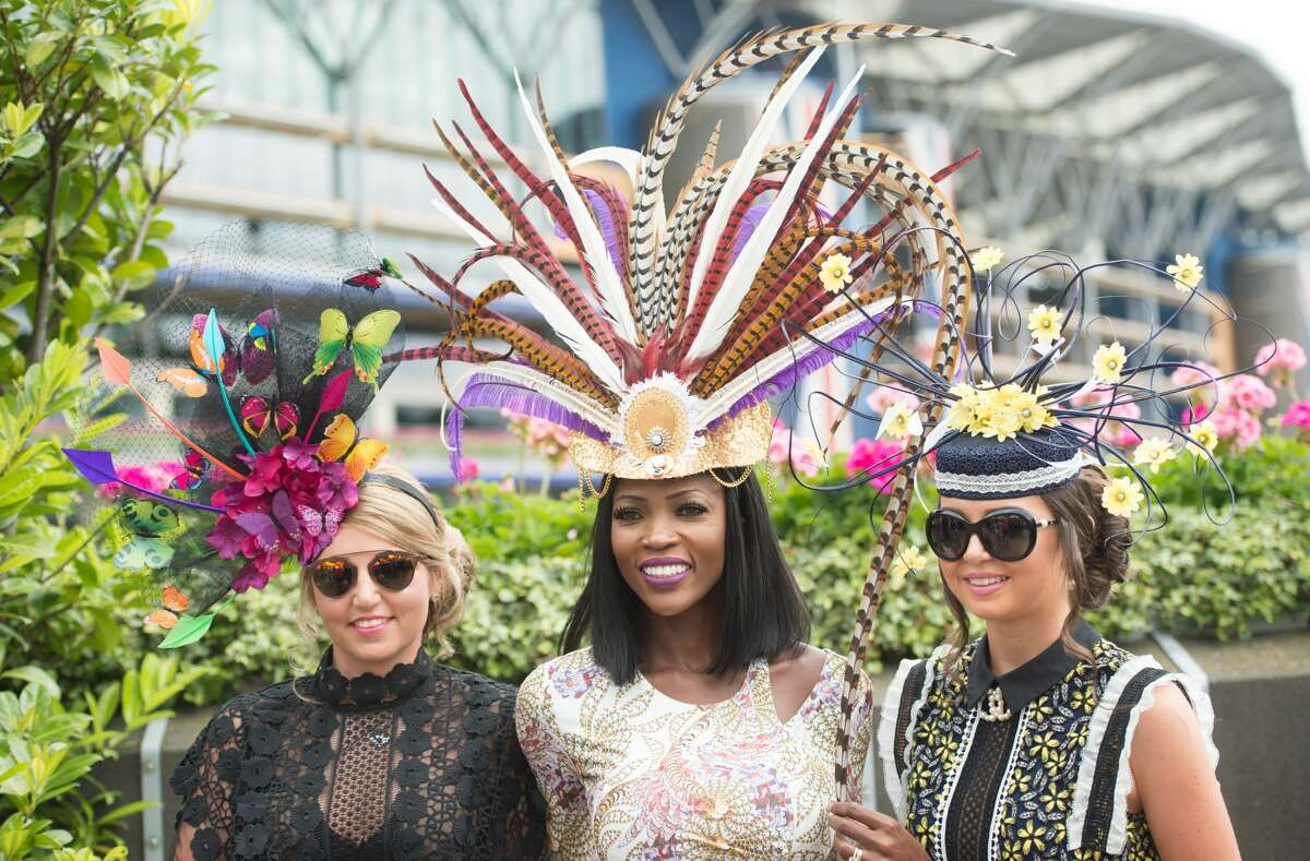 Three elaborate hats come together to block the views of everyone else.