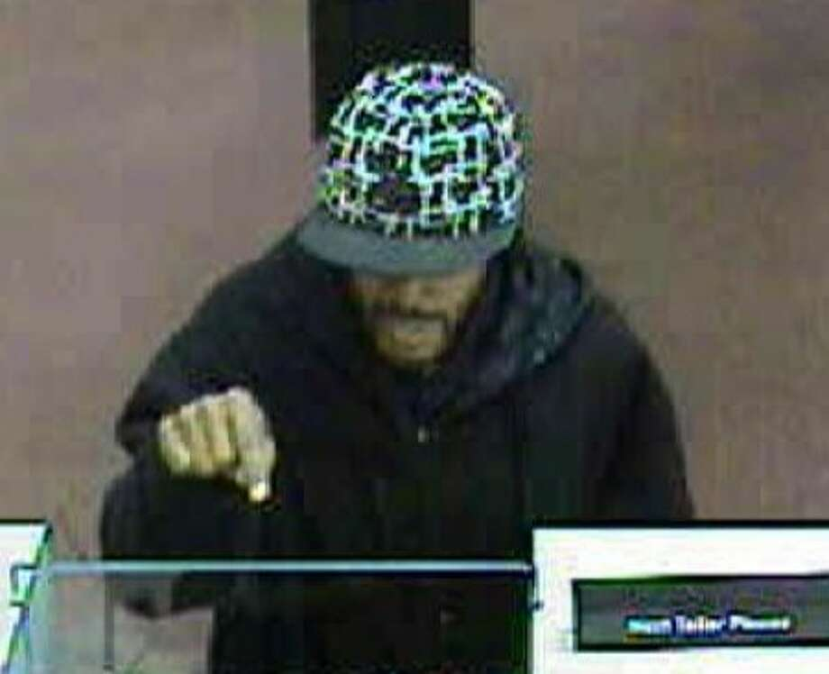 Police investigate bank robbery in WalMart shopping plaza