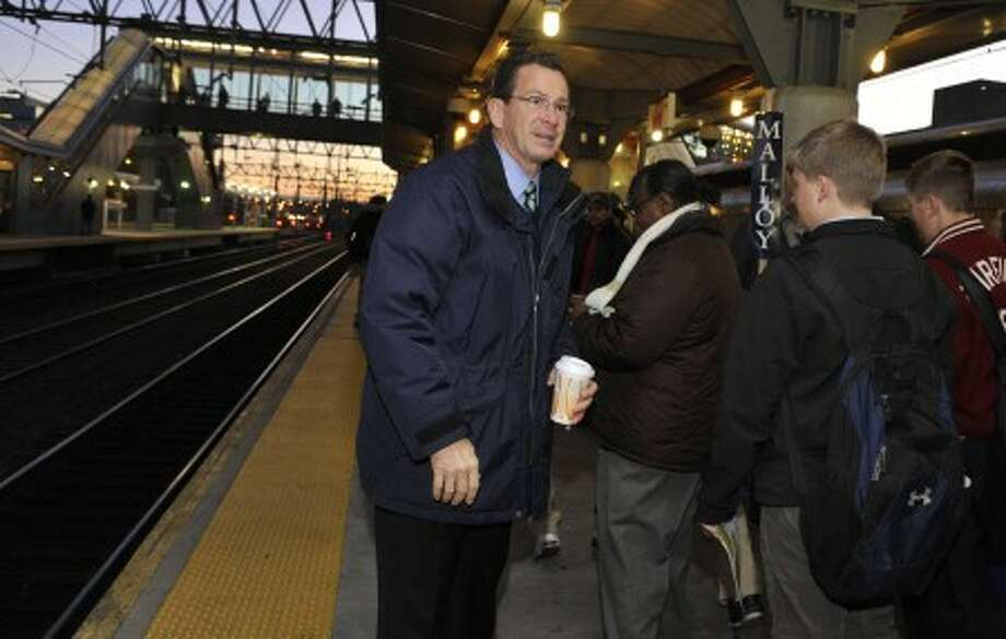 Democratic candidate for governor Dan Malloy greets people at the Stamford Train Station during a campaign stop in Stamford, Conn., Tuesday, Nov. 2, 2010. (AP Photo/Jessica Hill)