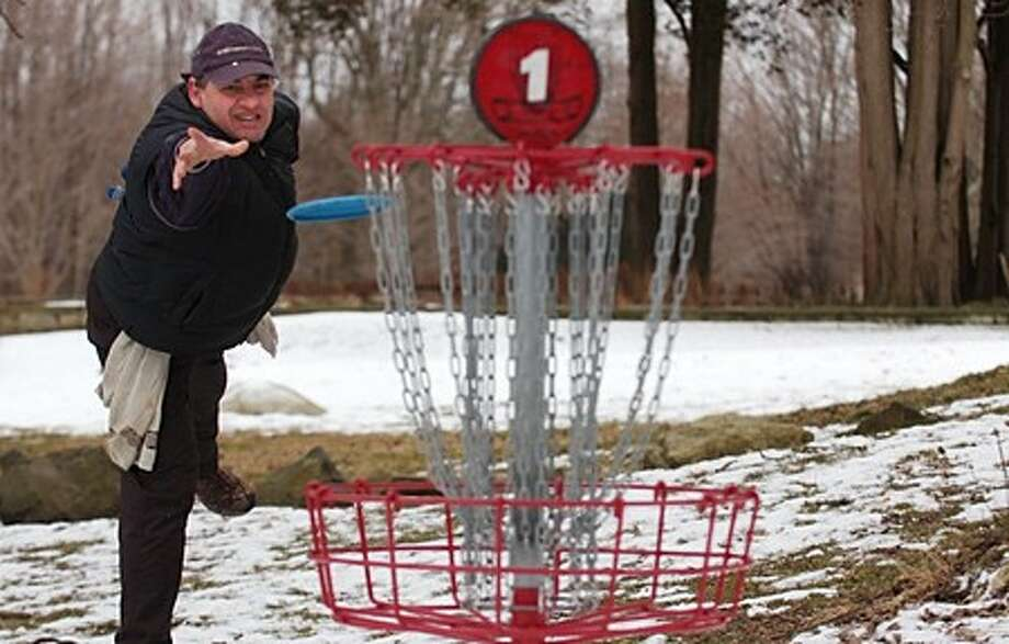 Norwalk resident Matt Jackson participates in the annual Ice Bowl disc golf tournament Saturday at Cranbury Park. Hour photo / Erik Trautmann