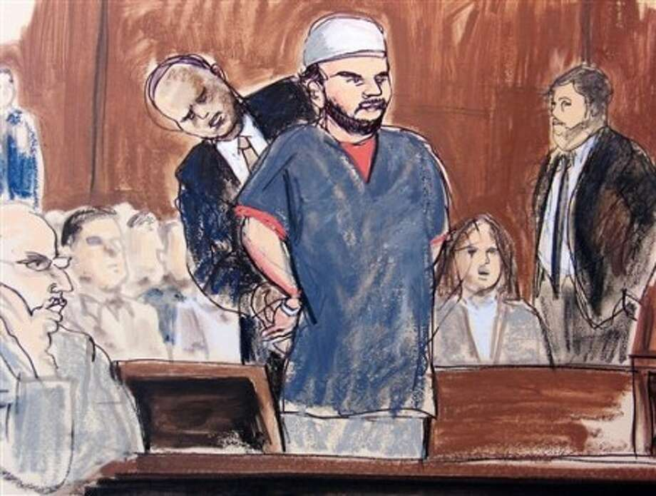 In this courtroom sketch, a U.S. Marshall removes Faisal Shahzad''''s handcuffs in the courtroom Monday, June 21, 2010, in New York. Shahzad, who appeared in federal court on an indictment accusing him of plotting a failed Times Square car bombing, was told by a judge that his hearing is being postponed until later Monday afternoon. He''''s accused in a plot that fizzled when a gasoline-and-propane bomb failed to ignite in a sport utility vehicle parked near a Broadway theater May 1. (AP Photo/Elizabeth Williams)