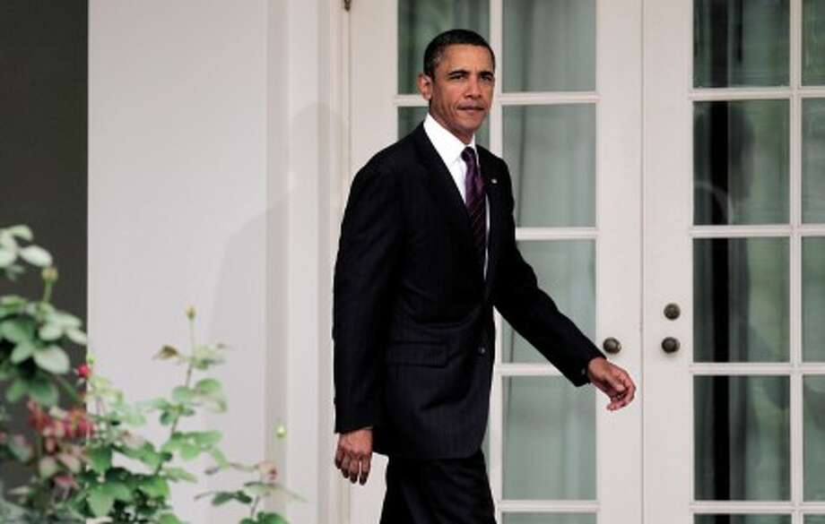 President Barack Obama walks to the Rose Garden of the White House in Washington, Friday, Sept. 3, 2010, to report on the economy. (AP Photo/J. Scott Applewhite)