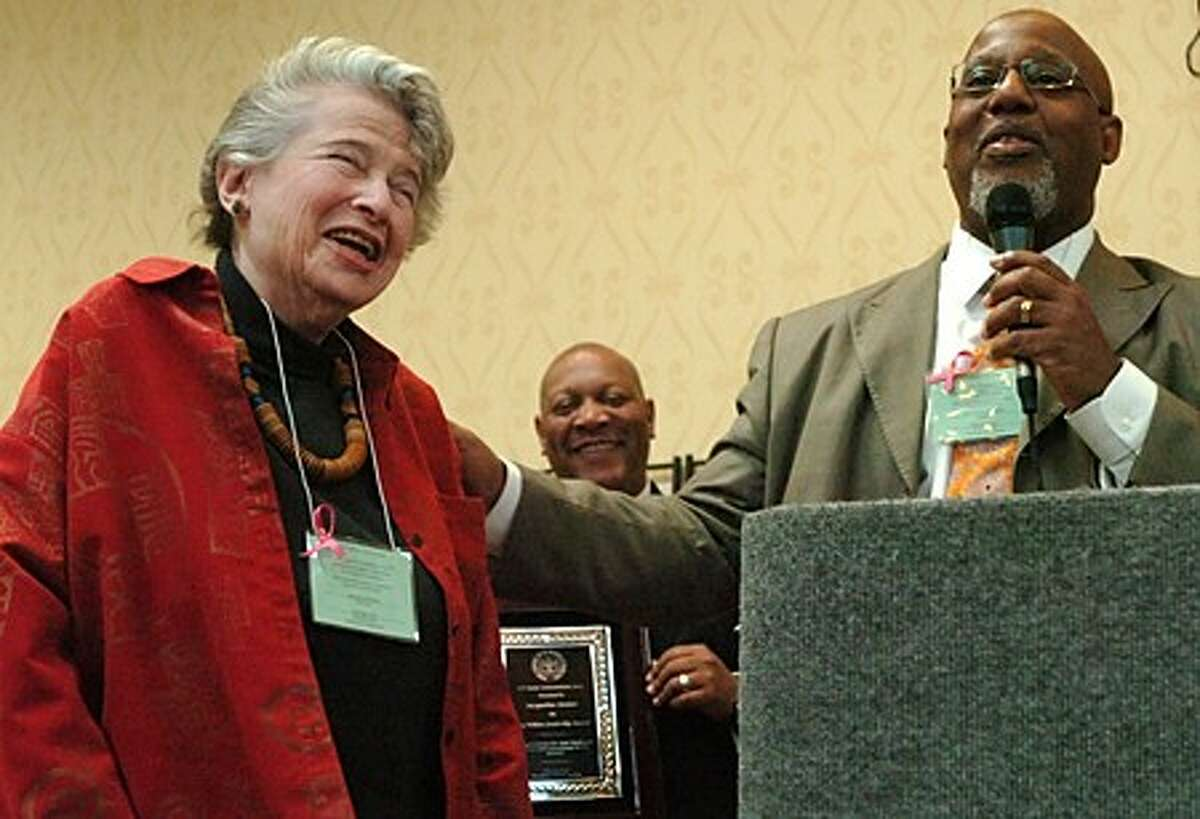 Jacqueline Steiner recieves the 2010 Roy Wilkins Award from the Reverend Lindsay Curtis while NAACP President Scot Esdaile looks on during the CT State Conference of NAACP Equal Opportuniy / Civil Rights Luncheon Saturday at the Holiday Inn in Stamford. Hour photo / Erik Trautmann
