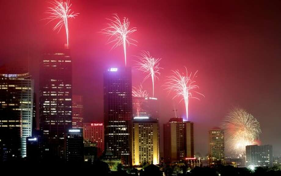 The sky above tall Sydney city buildings light up with the 9pm fireworks display on the new year''s eve in Australia, Friday, Dec. 31, 2010. Enthusiastic Australians camped out at parks alongside the Sydney Harbour Bridge to win the best view of the spectacular New Year''s Eve fireworks kicking off celebrations around the world. (AP Photo/Rob Griffith)