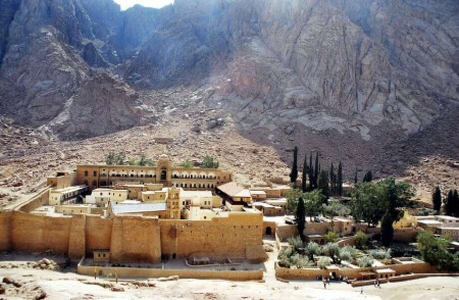 FILE - This Oct. 15, 2009 file photo shows Saint Catherine''s Monastery, founded by the Emperor St. Justinian the Great in 527, at the foot of Mount Sinai in Saint Catherine, Sinai, Egypt. The monastery is Greek Orthodox and is a UNESCO World Heritage Site. (AP Photo/Hussein Talal, File)