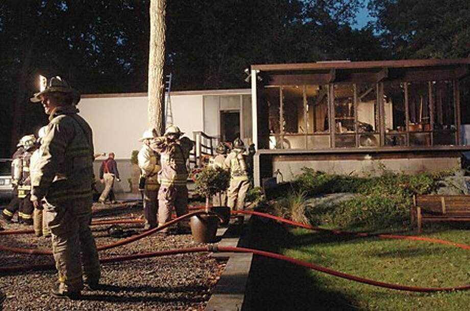 Fire crews respond a house fire on Old Kingdom Road in Wilton at around 6:00 Monday. hour photo/matthew vinci