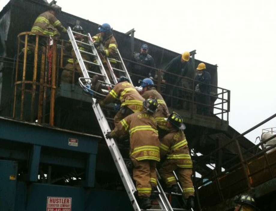 Stamford firefighters rescue a worker at Rubino Brothers Inc. after the employee was struck in the head while operating a machine that processes a variety of metals for recycling. Photo courtesy of Stamford Fire & Rescue.