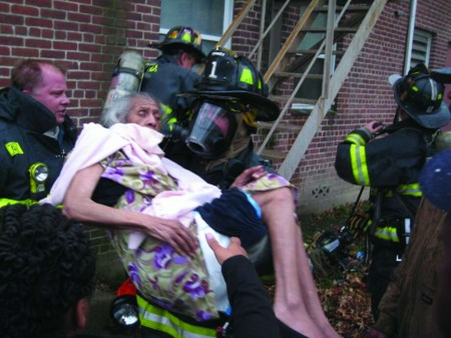With 98-year-old Hazel Fuller trapped on a fire escape with smoke billowing ... Firefighters recount dramatic rescue