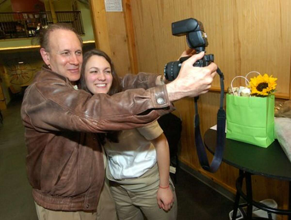 Photo/Alex von Kleydorff. Gabby Wang Girls Scout Troop 50808 has a self portrait taken with Dad Nathan after she was awarded the Gold Medal at Trackside Teeen Center on Sunday
