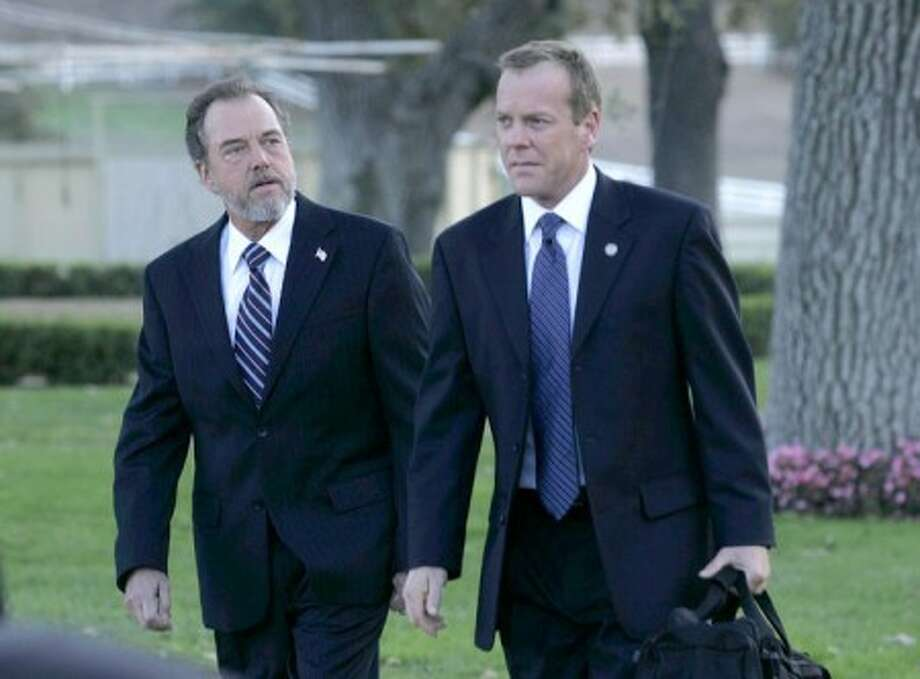 """Gregory Itzin who portrays Former President Charles Logan, and Kiefer Sutherland who portrays Jack Bauer, are shown in a scene from the series, """"24."""" (AP Photo/Fox, Kelsey McNeal)"""