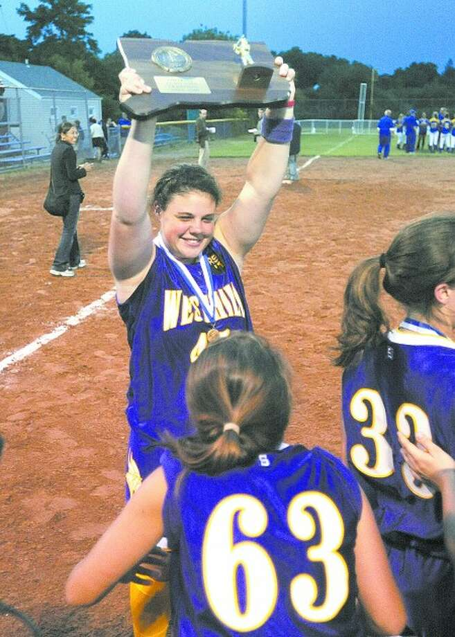 Westhill softball pitcher and co-captain Jen Joseph hoists the Class LL state championship trophy. Times photo/John Nash