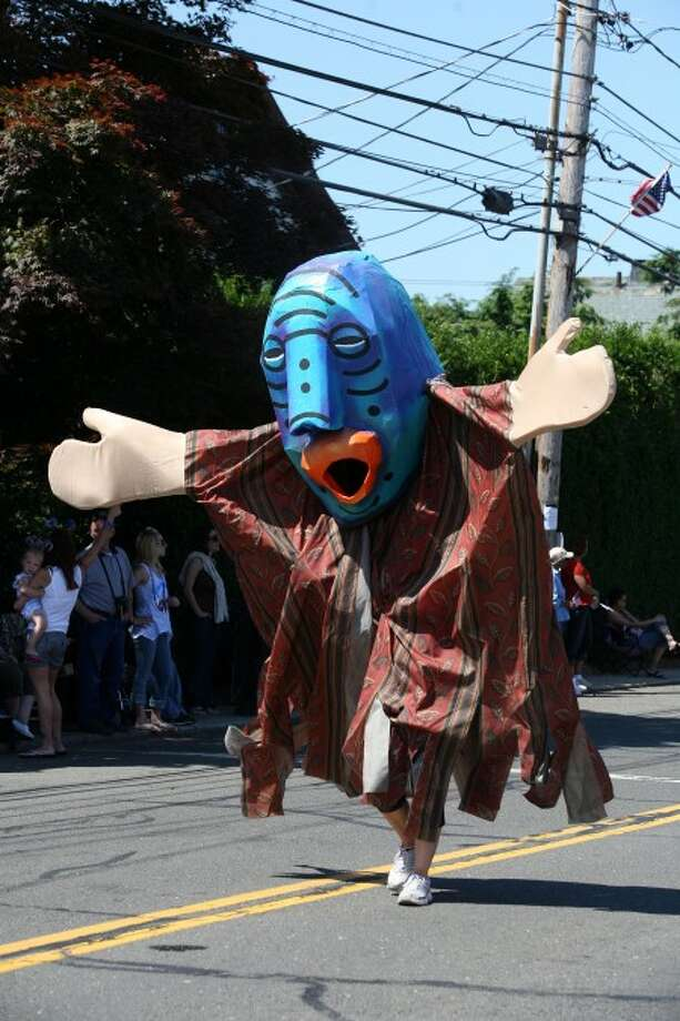 A character from the Sono Arts Festival parade walks in Norwalk''s annual Memorial Day parade Monday morning. Hour Photo / Danielle Robinson