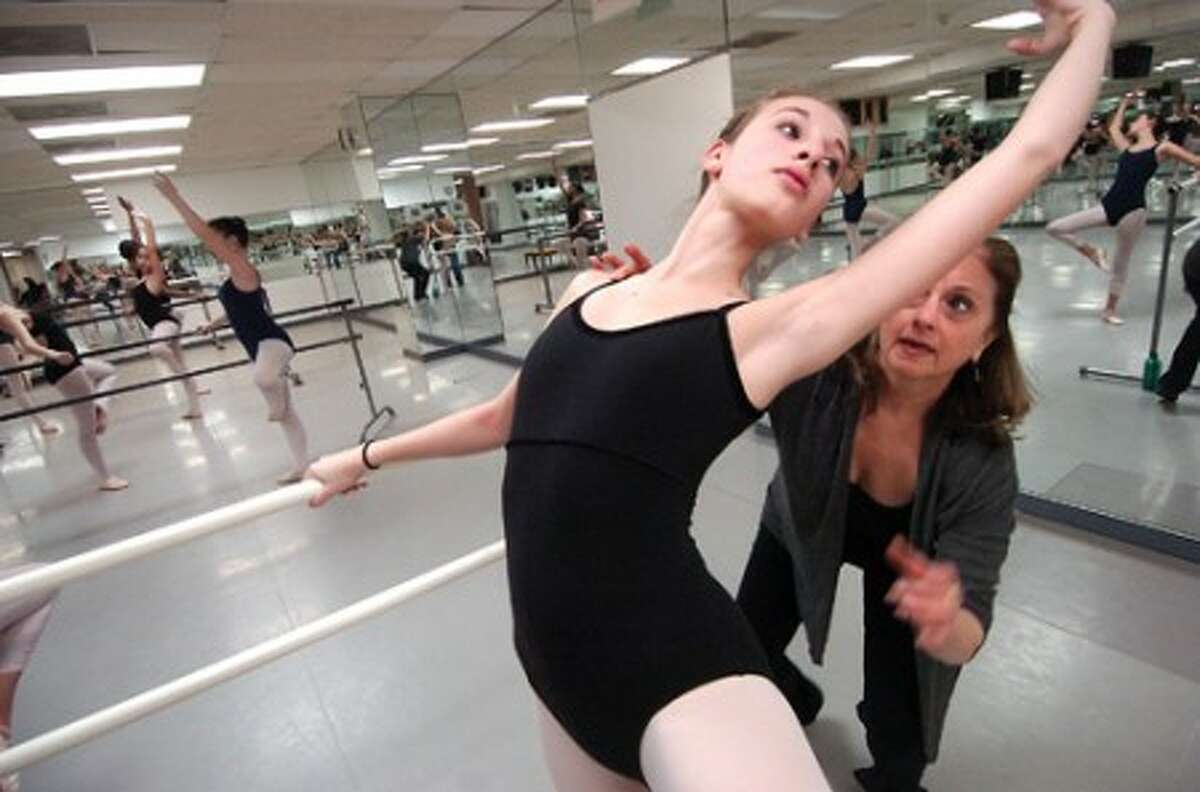 Photo/Alex von Kleydorff. 14 yr old Claire Cohen gets some instruction from Carol Bryan in the Level 5 class at The Ballet School of Stamford.