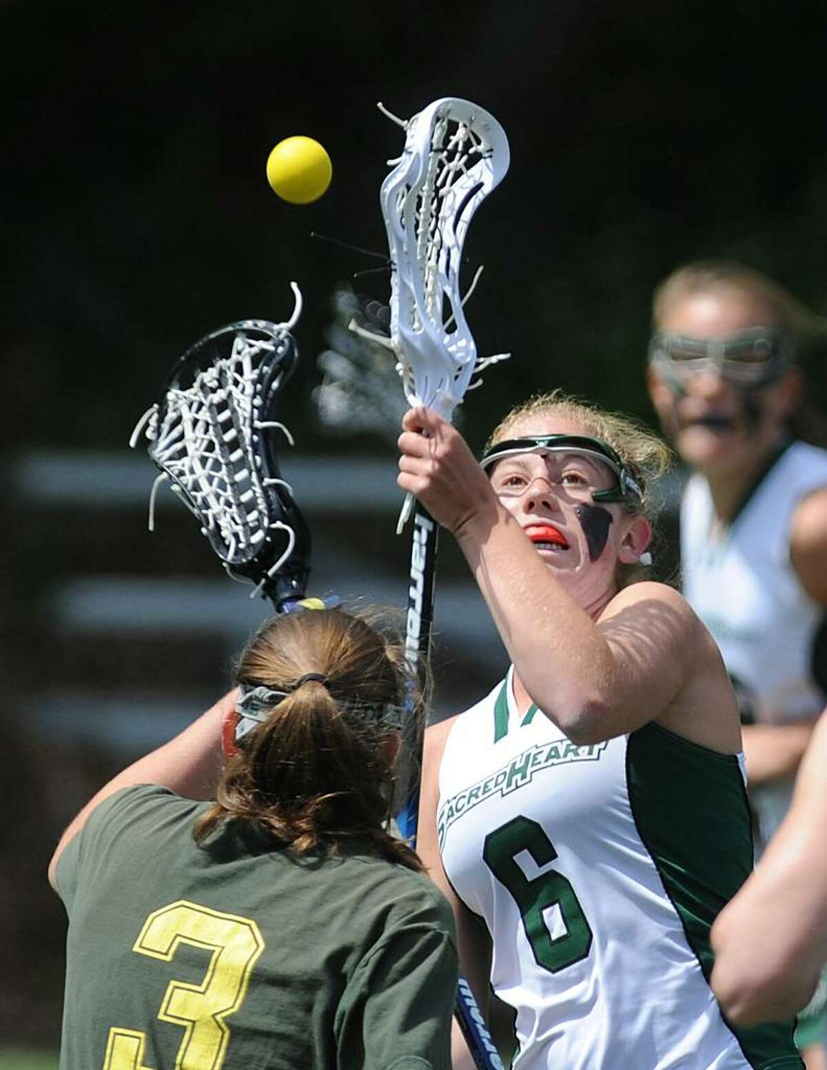 Tory Bensen, # 6 of Convent of the Sacred Heart, right faces-off against Alexa Pujol, # 3, of Greenwich Academy, during lst half action at GA, Saturday. GA defeated CSH, 19-15.