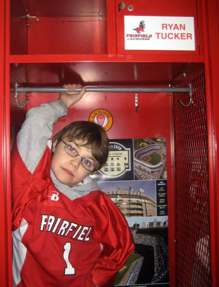 Ryan Tucker in front of his locker at Fairfield University after another lacrosse team win.Through the with Friends of Jaclyn (FOJ) Foundation the Fairfield University men's lacrosse team adopted seven-year old Ryan Tucker of Wilton, Conn. Photo: Contributed Photo / Connecticut Post Contributed