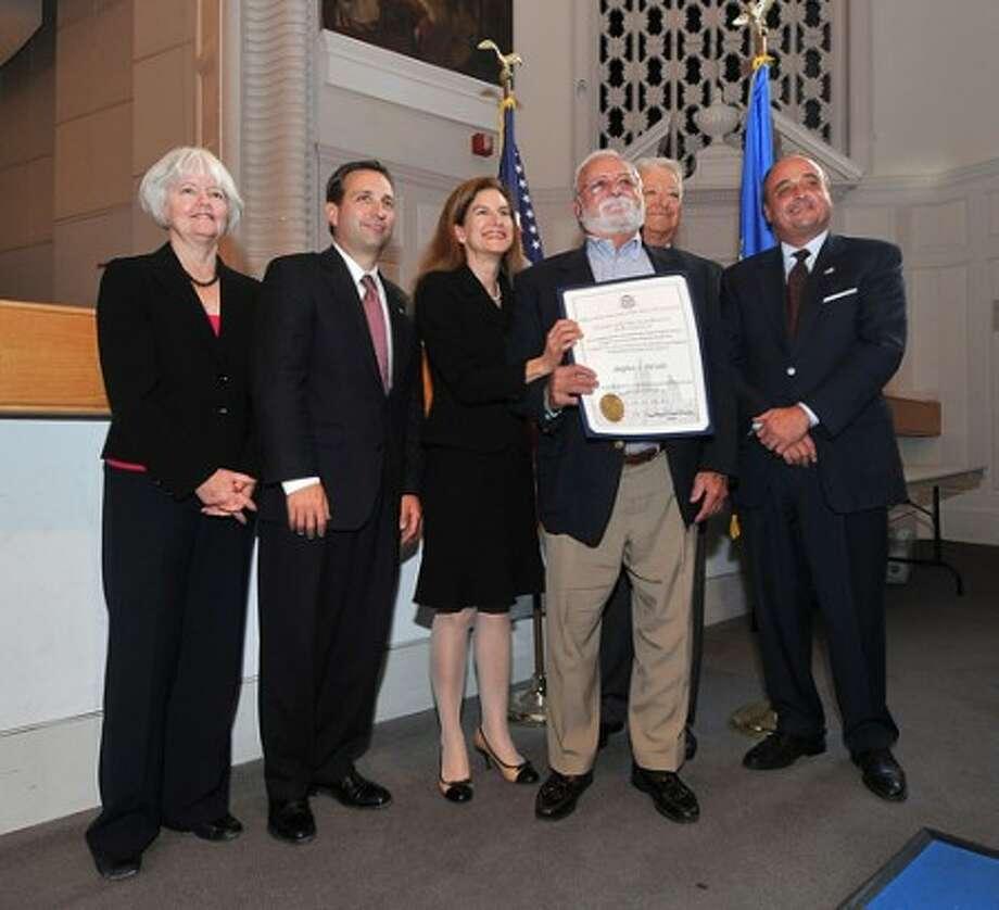 Photo/Alex von Kleydorff. Korean War Veteran John Cutrone recieves his certificate from Secretary of State Susan Bysiewicz.