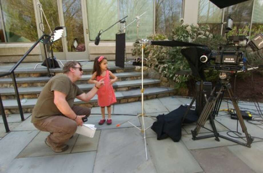 Photograph/Alex von Kleydorff. Director Alan Blake, owner of Blake and Company Films, works with 4yr old Amira Srivastavaduring at Leaps N'' Bounds Child Care Center during filming of a documentary about Solar energy in and around Wilton last week