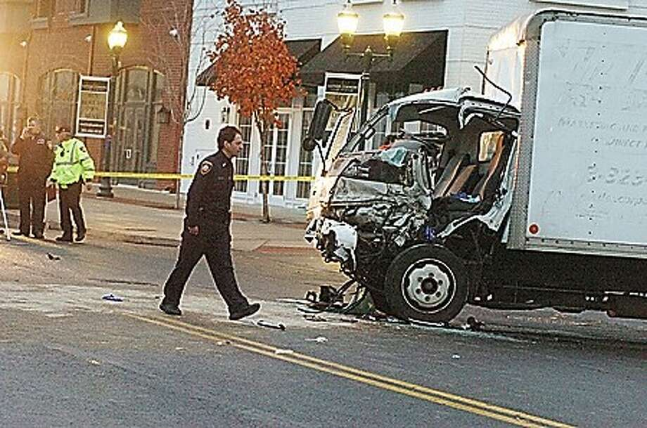 A truck on East Main street in Stamford hit a school bus at around 4:00 Tuesday and caused many cars to collide over the area and side streets. hour photo/matthew vinci