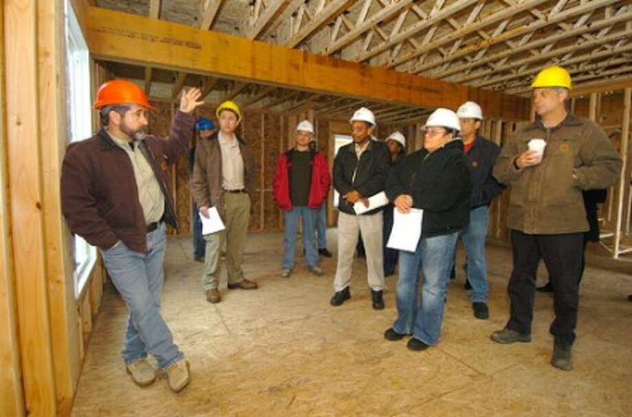 Photo/Alex von Kleydorff. Summerview Development On Site Project Manager Steve Berko talks to a group of NCC students inside one of the rental units under construction in Norwalk.