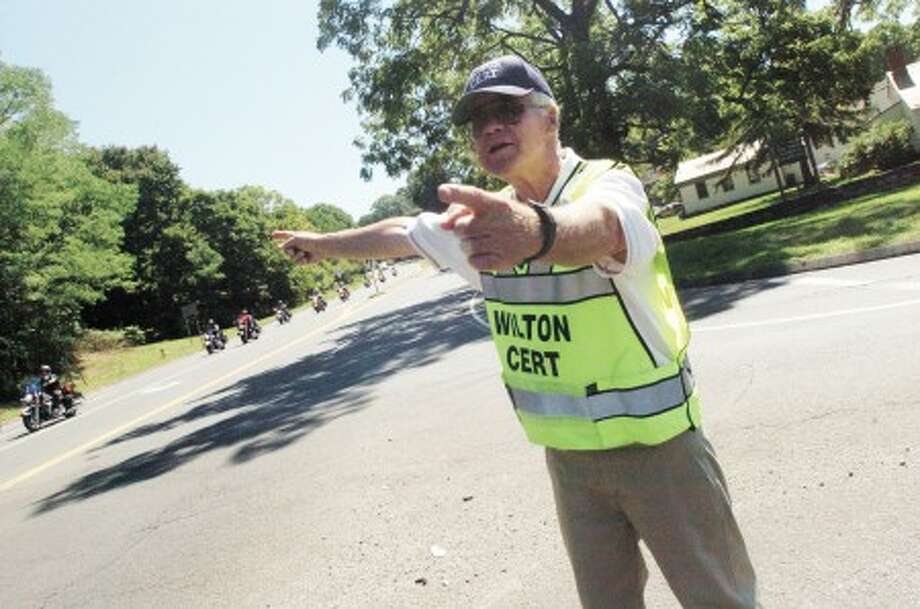 Wilton CERT, Jack Majesky directs traffic along Route 7 in Wilton Sunday as the United Ride came through. photo/matthew ivnci