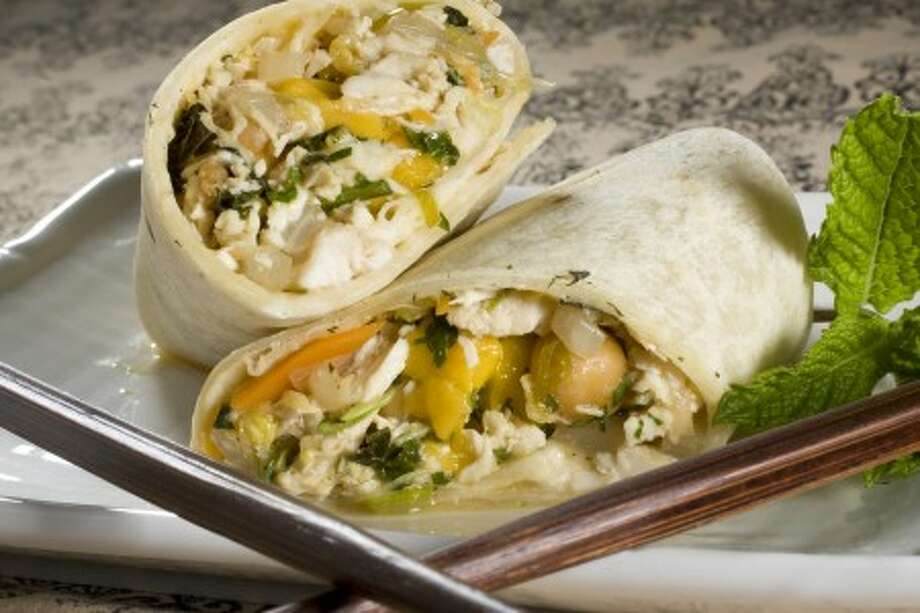 Thai-style chicken wraps with mango salsa are seen in this May 16, 2010 photo. Easy to eat while maintaining a level of sophistication these wraps are great for a dinner alfresco. (AP Photo/Larry Crowe)