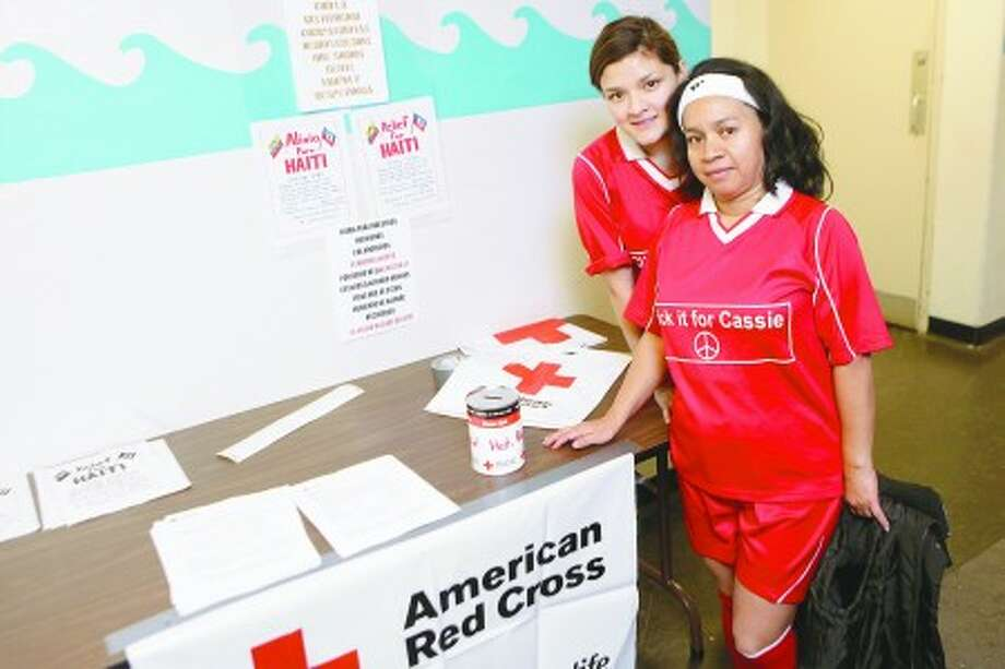 Petty Flores and daughter Kat Gomes collect donations during the Women''s soccer benefit for Haiti Sunday at Rogers Elementry School in Stamford. Hour photo / DAVID ESPOSITO