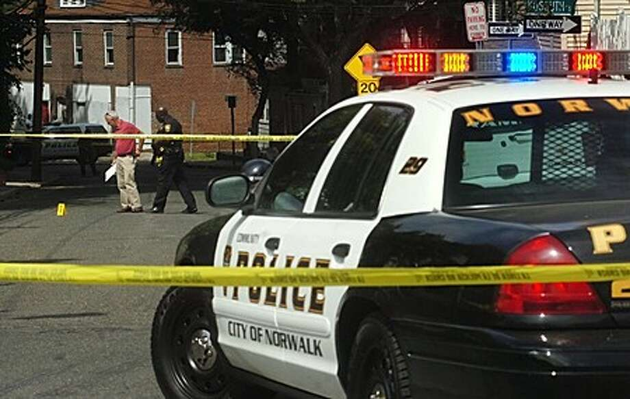 Norwalk police investigate a shooting on Lexington Ave Friday afternoon. Hour photo / Erik Trautmann